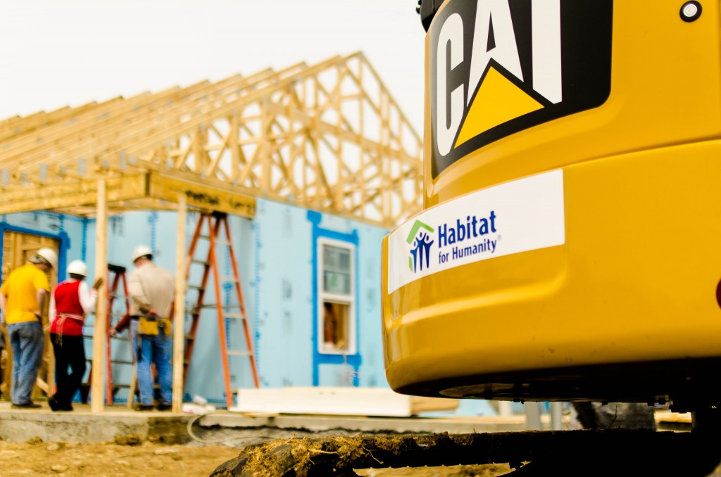 Thompson Cat builds Homes for Habitat For Humanity